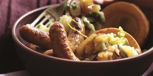 Cumberland Sausage With Colcannon Mash, Mini Yorkshires And Gravy