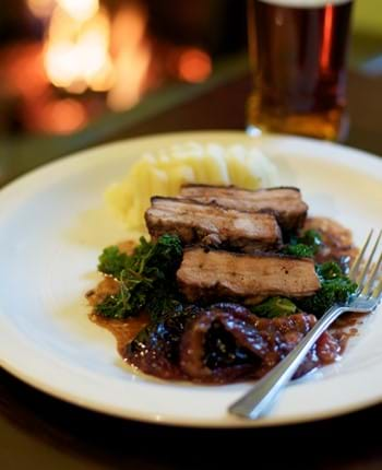 Pork belly with plums and cinnamon